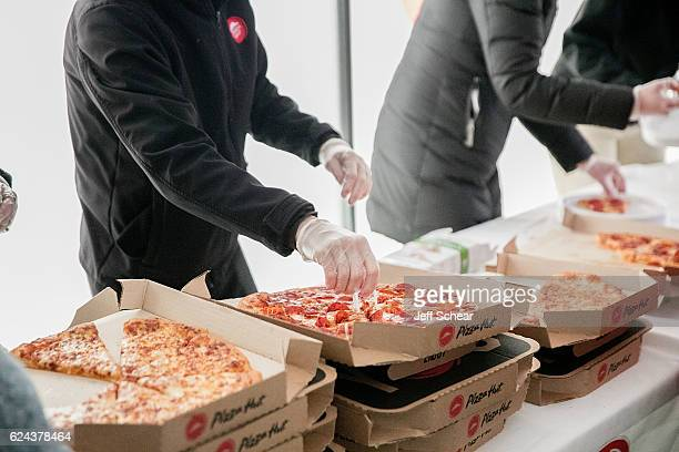 Cross country fans enjoy slices of Pizza Hut pizza at the Division I Cross Country Championship Pizza Hut served more than 3200 slices of pizza as...