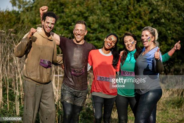 cross country runners cheering for camera after race - participant stock pictures, royalty-free photos & images