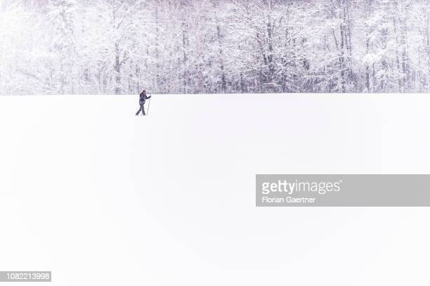 A cross country skier is pictured on a snowy field on January 11 2019 in JauernickBuschbach Germany