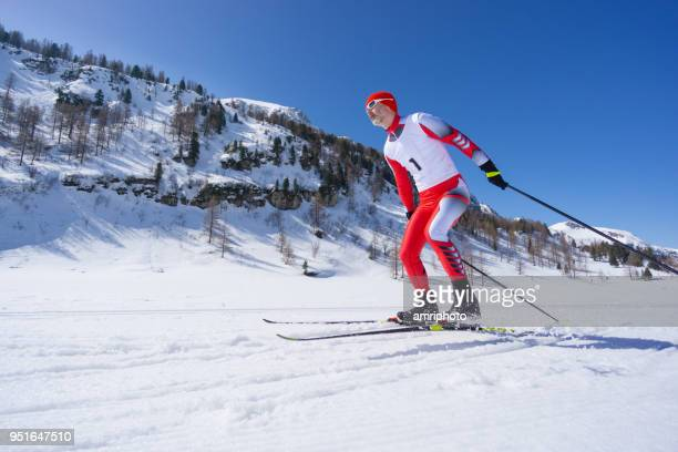 cross country skier skating alone - winter sports event stock pictures, royalty-free photos & images