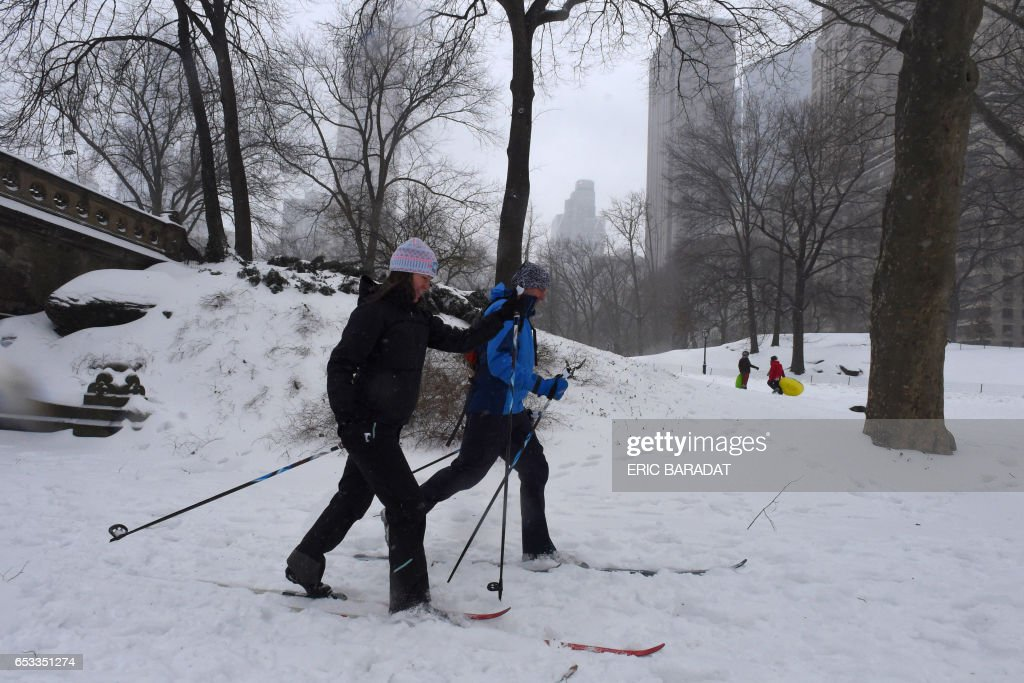 TOPSHOT - Cross country skiers enjoy a stroll in Central Park in New York city on March 14, 2017. Winter Storm Stella dumped sleet and snow across the northeastern United States on Tuesday but spared New York from the worst after authorities cancelled thousands of flights and shut schools. Blizzard warnings were in effect in parts of Connecticut, Massachusetts and upstate New York, but were lifted for New York City, the US financial capital home to 8.4 million residents, where snow turned to sleet, hail and rain. BARADAT