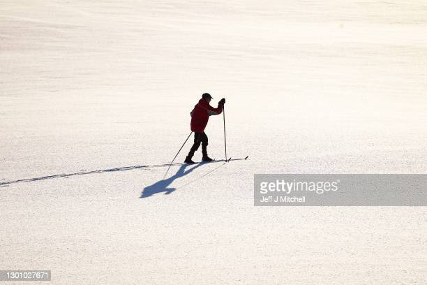 Cross country skiers make the most of the recent snow fall on February 8, 2021 in Tomintoul, Scotland. Weather warnings are in place in the UK for...