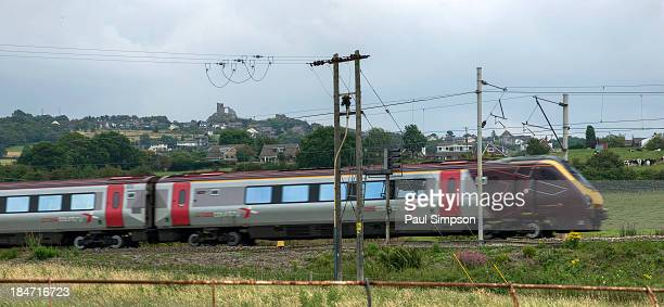 Cross Country train on the West Coast Main Line passing the National Trust property of Mow Cop castle on the Cheshire/Staffordshire border
