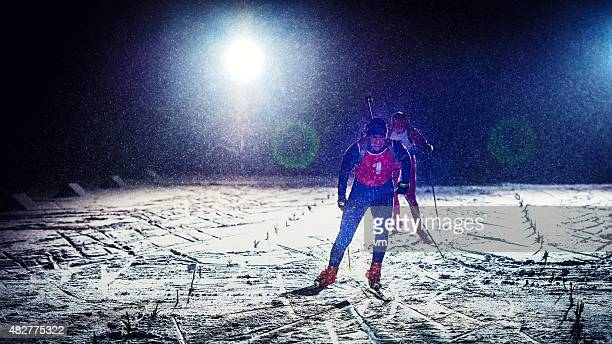 cross country training at night - langlaufen stockfoto's en -beelden