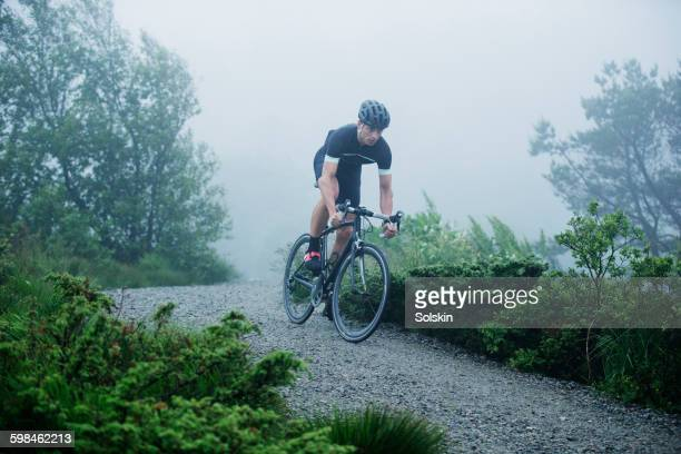 Cross cycling man on mountain dirt road
