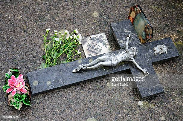 Cross decorating a tomb in graveyard, France, Europe