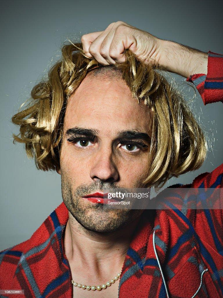 Cross Dressed Man Putting on Wig : Stock Photo