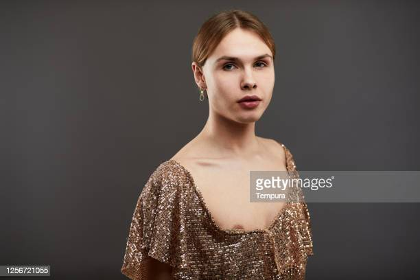 a cross dressing man studio portrait on plain backgorund. - gender fluid stock pictures, royalty-free photos & images