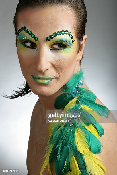 Cross Dressing Man Wearing Colorful Make-up and Feathers