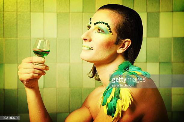 cross dressing man wearing colorful make-up and feathers - beautiful transvestite stock photos and pictures