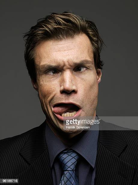 Cross eyed businessman being tongue and cheek
