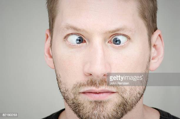 cross eyed man - cross eyed stock pictures, royalty-free photos & images