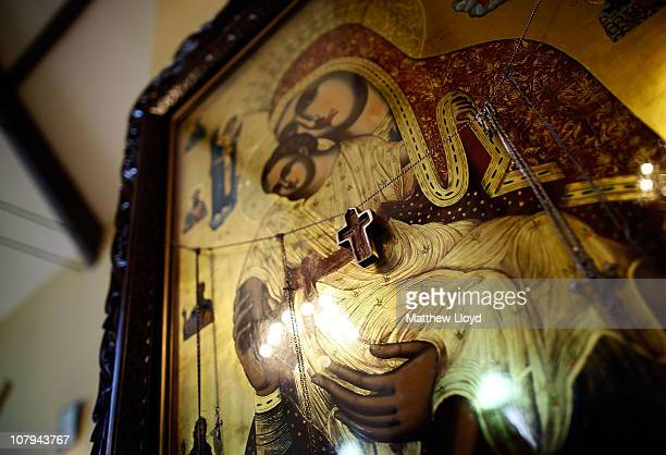 A cross hangs on an icon as His Eminence Gregorios Archbishop of Thyateira and Great Britain presides over the divine liturgy at the Parish of the...