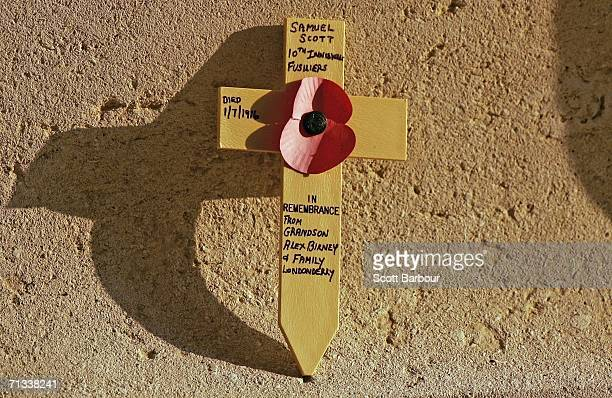 A cross in memory of a soldier killed in the Battle of Somme rests against the memorial at the Thiepval Memorial and AngloFrench Cemetery as the 90th...