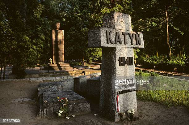 A cross in sunlight shows the Katyn memorial set in a forest in Warsaw Poland The Katyn war cemetery is a Polish military cemetery located in Warsaw...