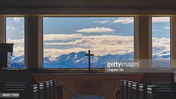 a cross inside church with mountain background - chapel stock pictures, royalty-free photos & images