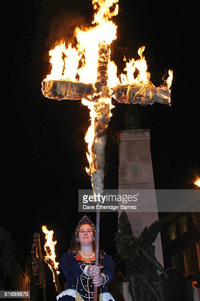 A cross is burned at the war memorial during the Bonfire Night celebrations on November 5 2004 in Lewes Sussex in England Bonfire Night is related to...