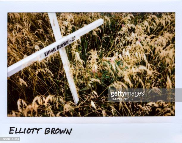 A cross is laid in honor of Elliott Brown 25yearold in a field next to New Life Covenant Church in Chicago Illinois on June 20 2017 Brown was shot in...