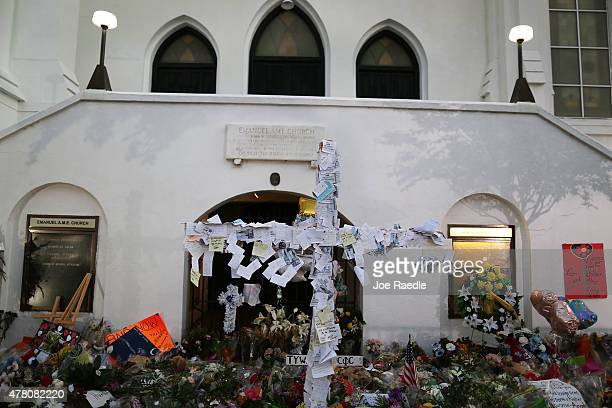 A cross is seen adorned with messages at a memorial in front of the Emanuel African Methodist Episcopal Church after a mass shooting at the church...