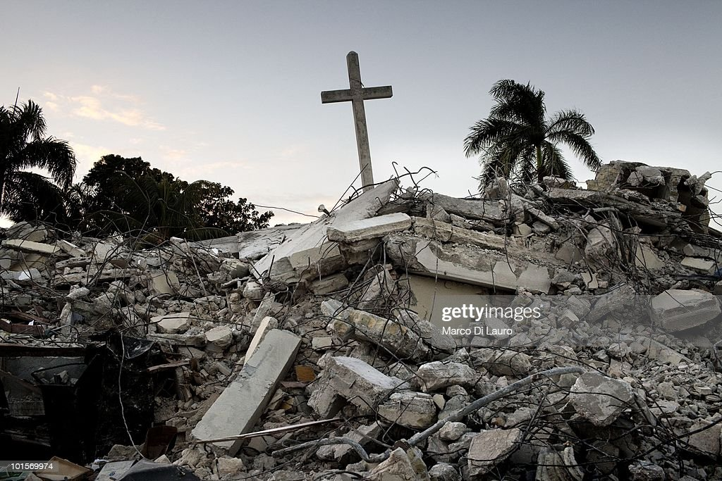 A cross is seen raising from the rubbles of a church destroyed during the earthquake on January 30, 2010 in Port Au Prince, Haiti. As many as 200,000 people died on January 12 as a consequence of the 7.0-magnitude earthquake. At least 130 people have been pulled alive from the rubble. An estimated 1.5 million people have been left homeless. The Haitian government is planning to relocate some 400,000 people, currently in makeshift camps across the capital, to temporary tent villages outside the city. Aid agencies are still struggling to supply food and water to survivors, while thousands of Haitians who suffered serious injuries remain in need of urgent medical attention.