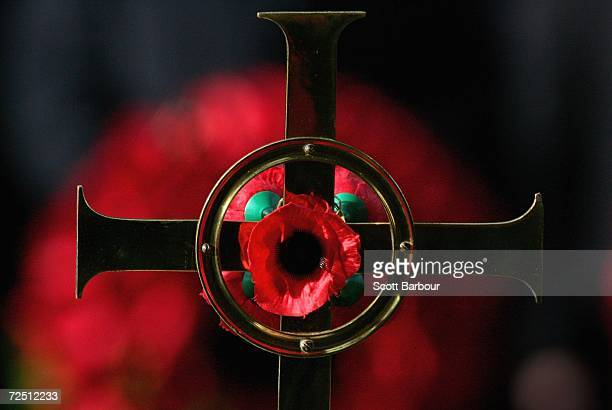 A cross laden with poppies is displayed during the Remembrance Sunday Service at The Cenotaph on November 12 2006 in London England The Festival of...