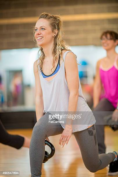 cross lunges with weights in aerobic fitness class - grip film crew stock photos and pictures