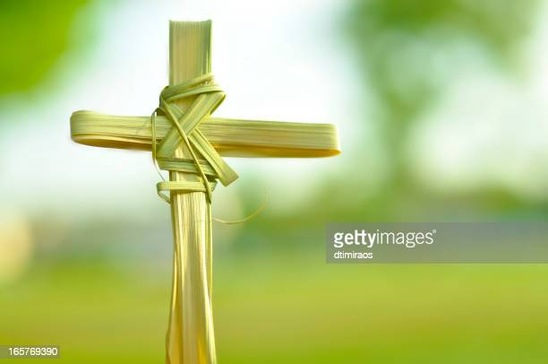 cross made out of palm fronds. - palm sunday stock pictures, royalty-free photos & images