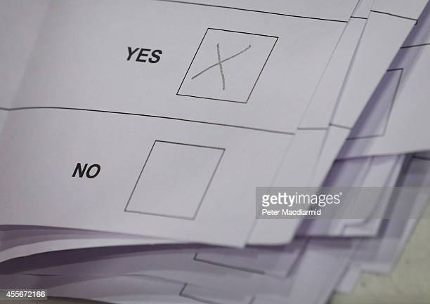 A cross marks a YES vote on a ballot paper at the count centre for the Scottish referendum on September 18 2014 in Aberdeen Scotland Polls have now...