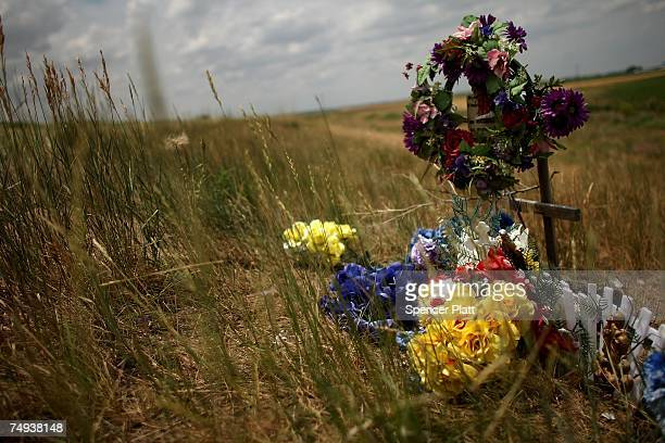 A cross marks the spot where a person lost their lives in a automobile crash June 27 2007 in Greeley Colorado Roadside memorials have proliferated...