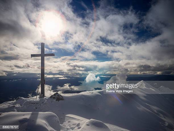 A cross on a mountain top in winter