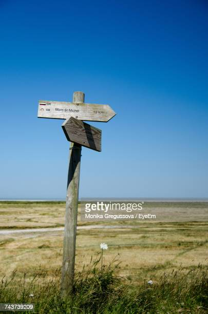 cross on field against clear blue sky - monika gregussova stock pictures, royalty-free photos & images
