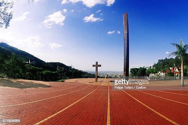 cross on israel pinheiro square against sky - belo horizonte stock pictures, royalty-free photos & images