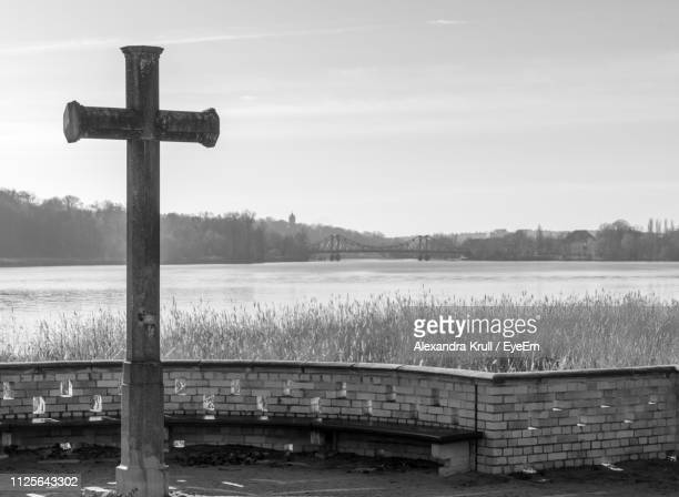 Cross On Lake Against Sky