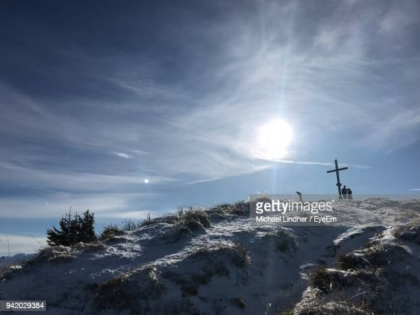 cross on mountain against sky - lenggries stock pictures, royalty-free photos & images