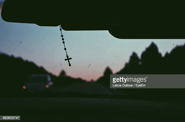 cross on rear view mirror - rosary beads stock pictures, royalty-free photos & images