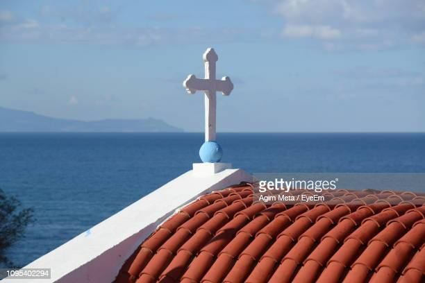 cross on sea against sky - agim meta stock pictures, royalty-free photos & images