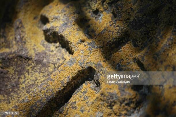 cross on stone in harichavank, armenia - モダンロック ストックフォトと画像