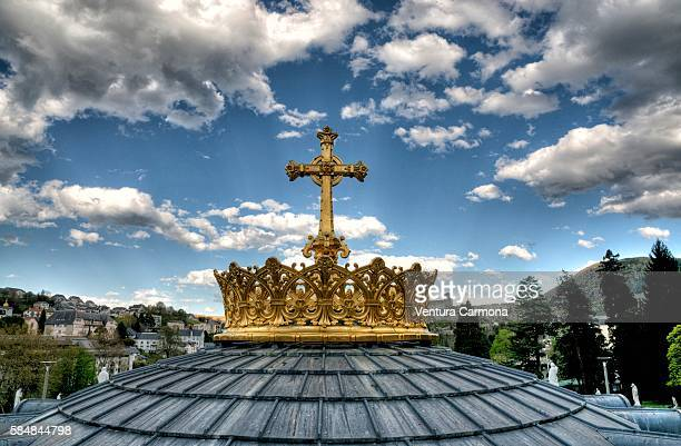 Cross on the Dome of Rosary Basilica in Lourdes (France)