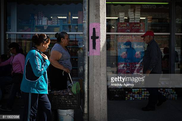 A cross painted as remembering of the womans who in recent years was kidnapped and killed is seen in the center of Ciudad Juarez Mexico on February...