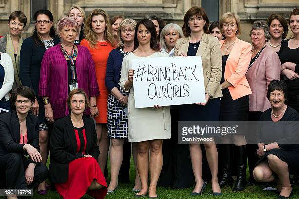 Cross party MP's gather outside the Houses of Parliament for a photocall to show their support for a group of abducted Nigerian Schoolgirls on May 13...