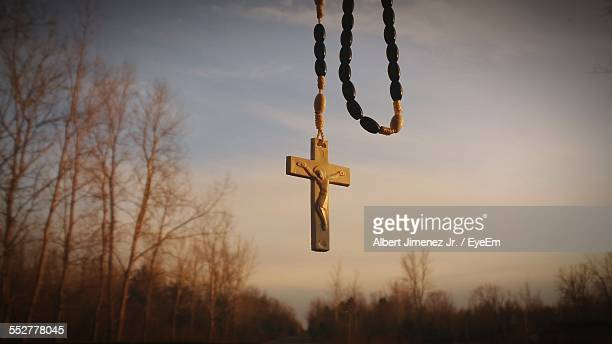 Cross Pendant Hanging Against Sky