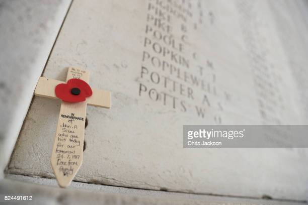 A cross rests within the Menin Gate next to the names of 50000 lost soldiers at the Commonwealth War Graves Commission Ypres Memorial on July 30 2017...