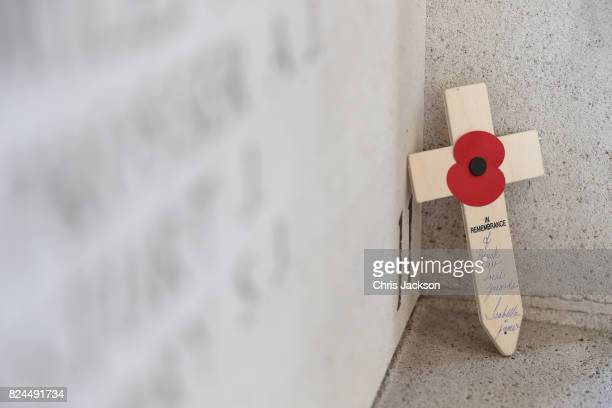 Cross rests within the Menin Gate next to the names of 50,000 lost soldiers at the Commonwealth War Graves Commission Ypres Memorial on July 30, 2017...