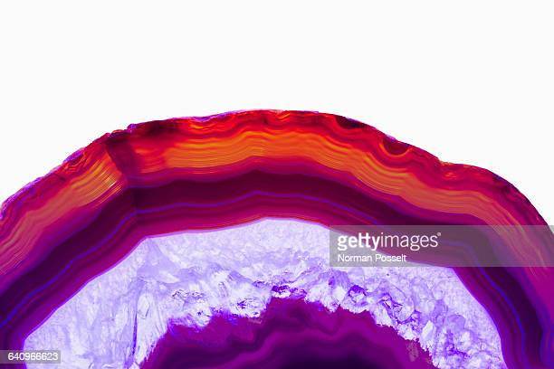 cross section detail of purple agate stone against white background - cross section stock pictures, royalty-free photos & images