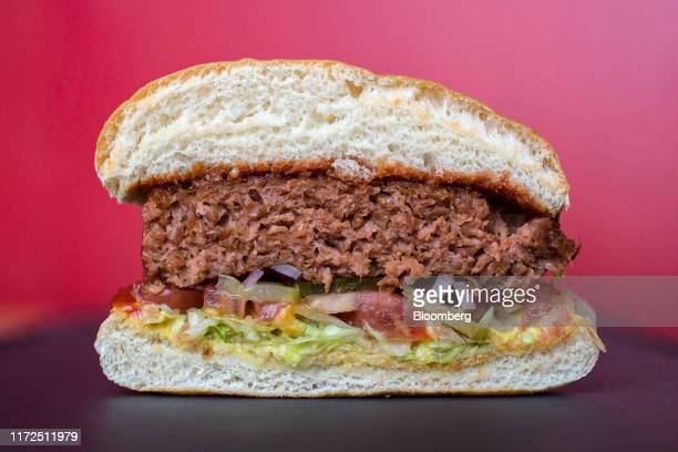Cross section of a 'beyond burger' displays the Beyond Meat Inc. Plant-based burger patty inside a TGI Friday's Inc. Restaurant in Moscow, Russia, on...