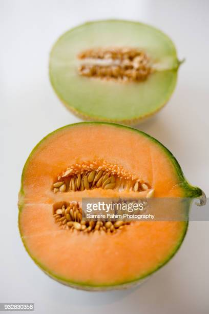 cross section of a cantaloupe and charantais melon on white background - samere fahim stock photos and pictures