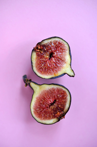 Cross Section Of Fig Isolated On Pink Background - gettyimageskorea