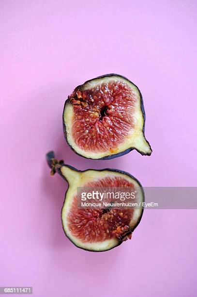 Cross Section Of Fig Isolated On Pink Background