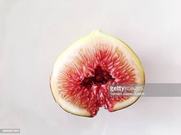 cross section of fig on white background - fig stock pictures, royalty-free photos & images