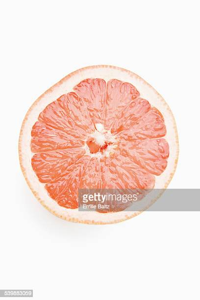 Cross section of grapefruit against white background